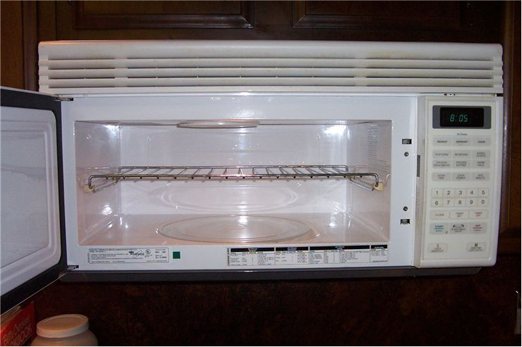 Picture Of Microwave Oven With A Metal Shelf